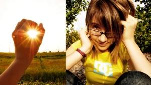 girl grasping sun
